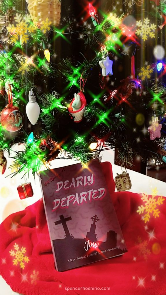 Picture of Dearly Departed by Jinx under a Christmas tree